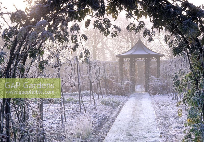 Pathway leading to gazebo in winter
