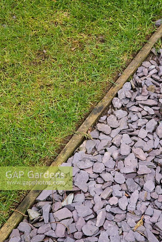 Gap gardens wooden edging to separate lawn and slate for Wooden garden edging