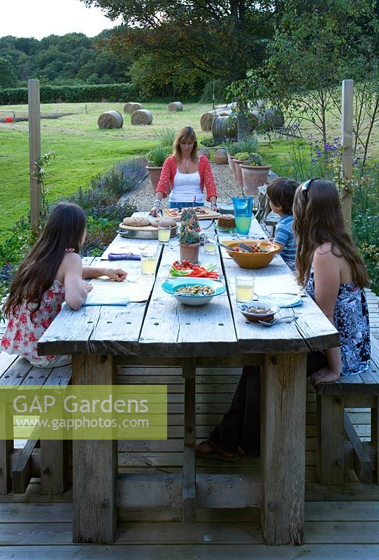 Clare Matthews Garden Blog Free Chive Edging Is Looking: Woman And Children Eating At Outside Dining