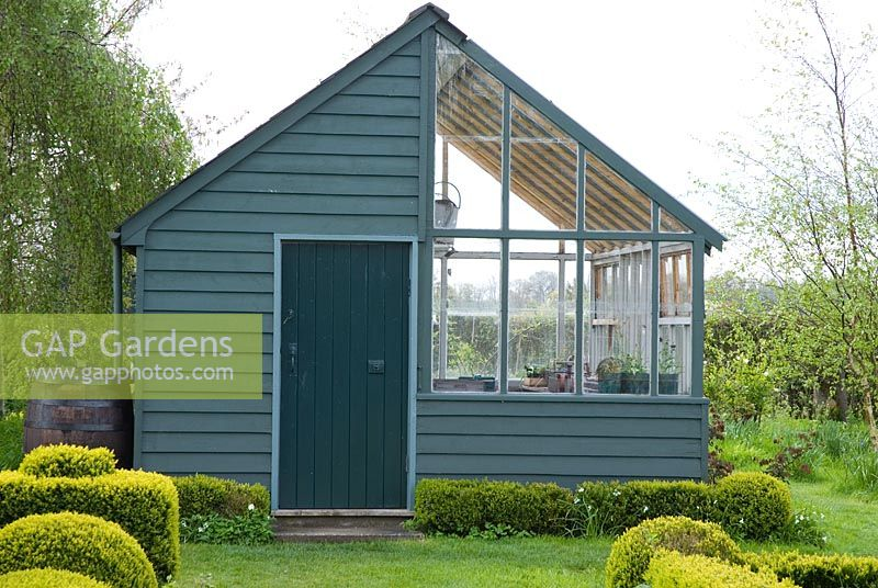 Painted timberboard greenhouse