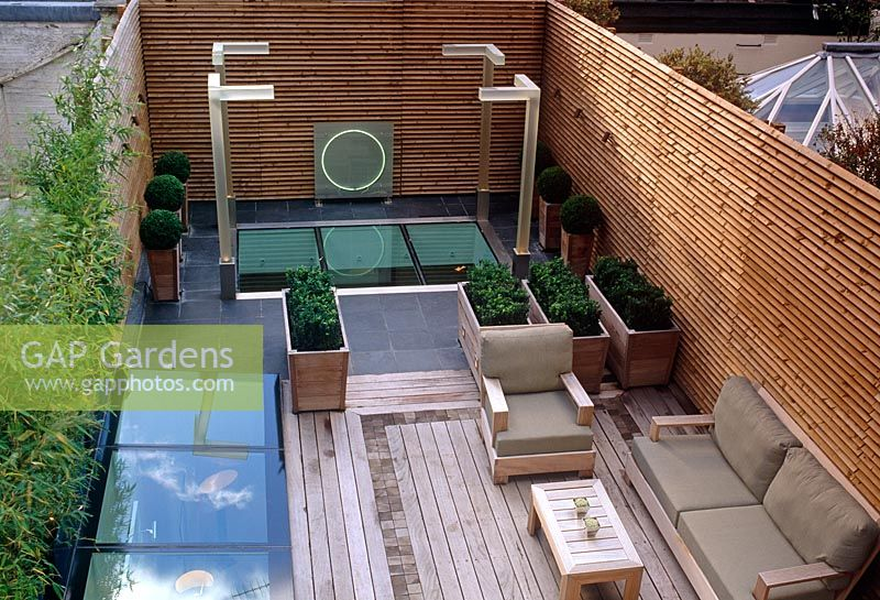 Contemporary Small Urban Roof Garden With Decking, Seating And Buxus  Spheres In Containers   Wilton