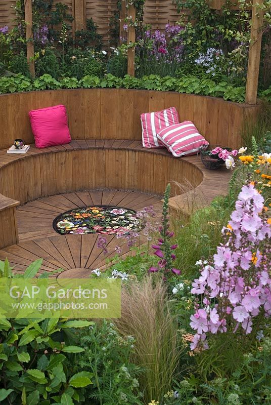 GAP Gardens - Sunken wooden seating area with tiled centrepiece in ...