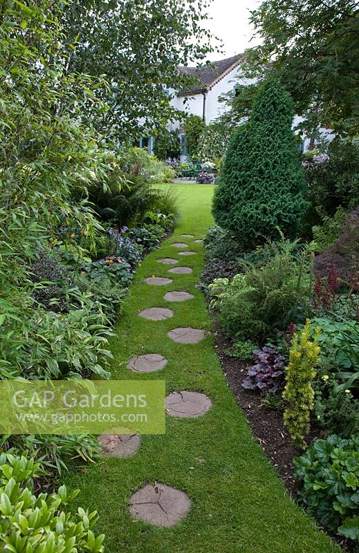 Gap gardens long grass path with wooden stepping stones leading to long grass path with wooden stepping stones leading to back of house and patio area with workwithnaturefo