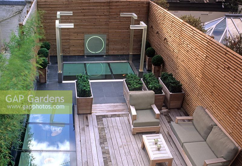 gap gardens contemporary rooftop garden with decking seating