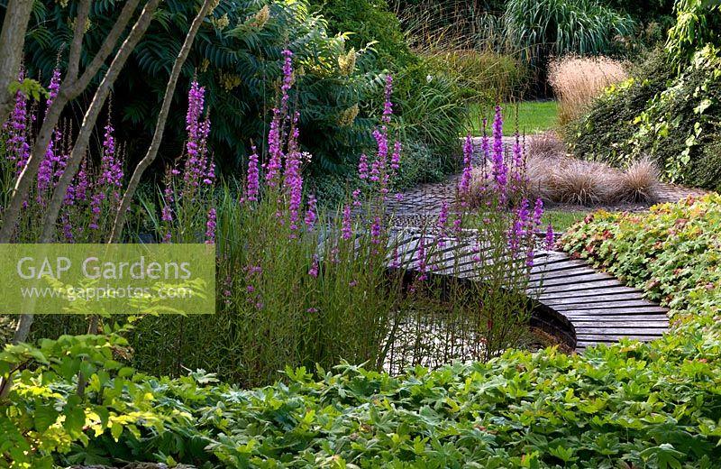 Gap Gardens Circular Pathway Surrounds A Small Pond