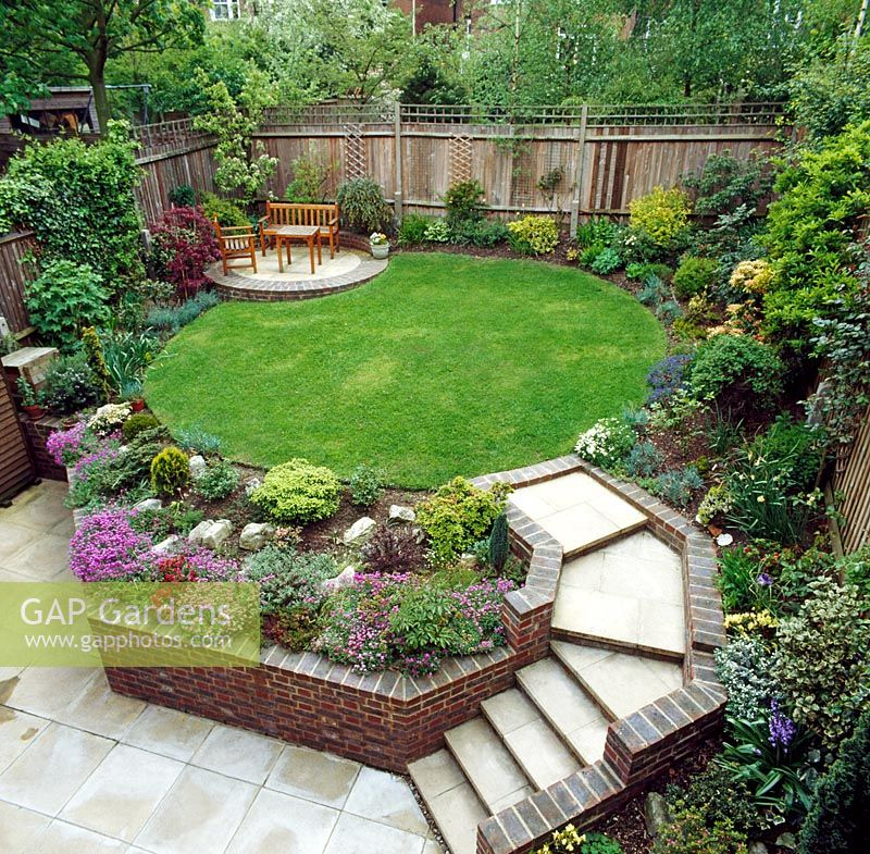 Gap gardens suburban garden with raised lawn and for Garden sectioning ideas