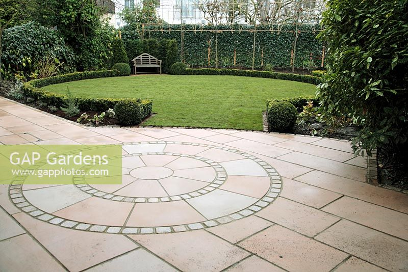 Circular Patio Design In Indian Sandstone   Cut And Sandblasted, Newly Laid  Lawn In December