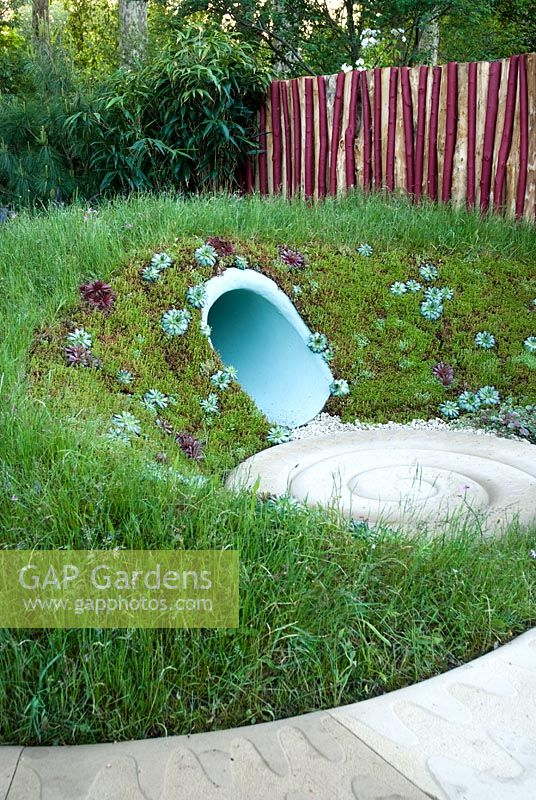 Snake path and tunnel with bank of succulents at The Marshalls Garden That Kids Really Want! - RHS Chelsea Flower Show 2008