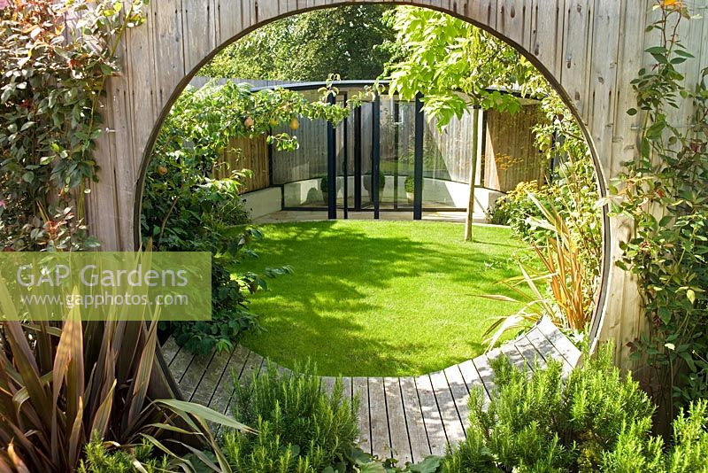 Gap gardens circular entrance leading to decking area for Circular garden decking