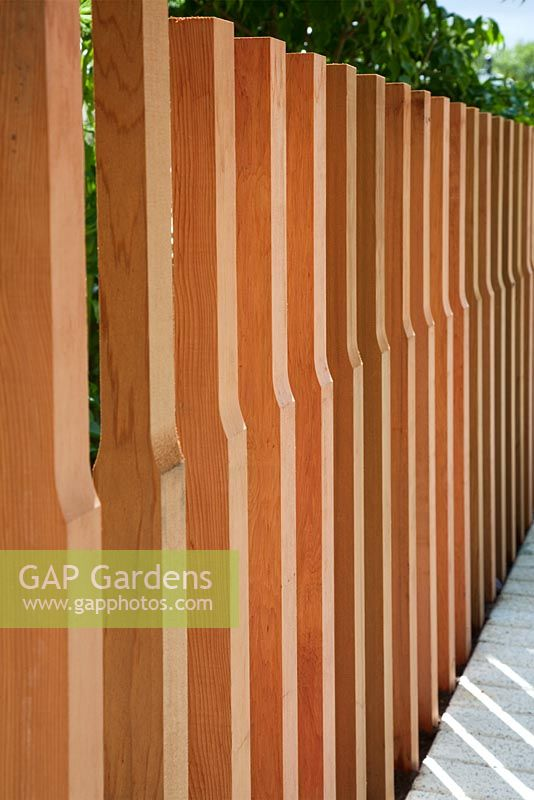 Gap gardens shaped vertical timber fence posts in the