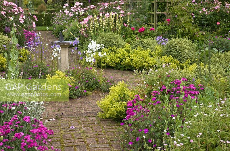 Scented Garden With Ornate Sundial With Butterfly Feature, Paved Pathways  And Scented Bush Roses And