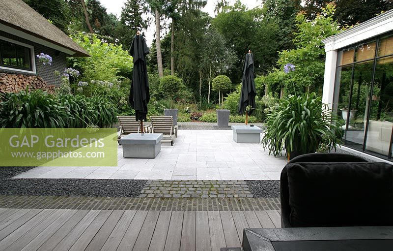 Patio Area Of Suburban Garden Made Orted Materials Agapanthus In Containers