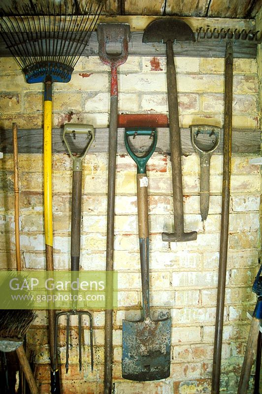 Garden Tools Hanging Up In A Shed.