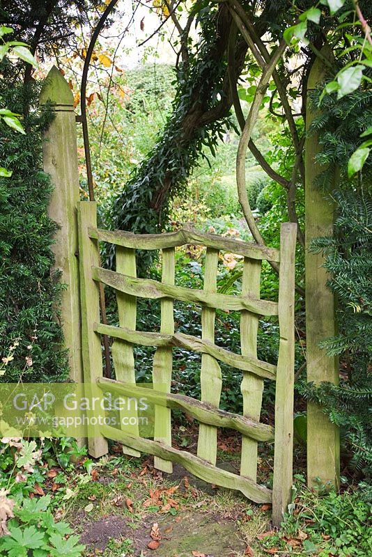 Gap gardens rustic wooden gate leading through to front for Garden gate designs wood rustic