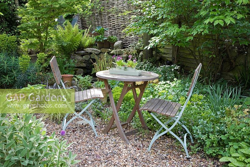 Gap Gardens Wooden Table And Chairs On Shady Gravel