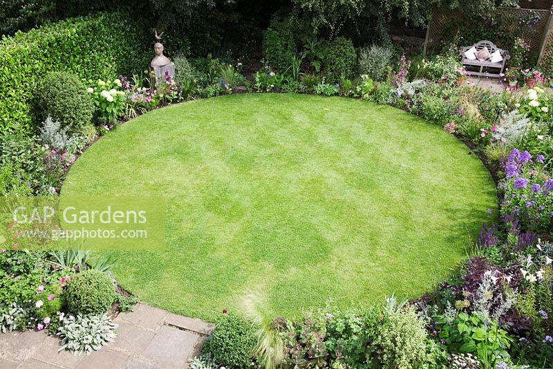 gap gardens overview of small urban garden packed full of plants - Garden Design Circular Lawns