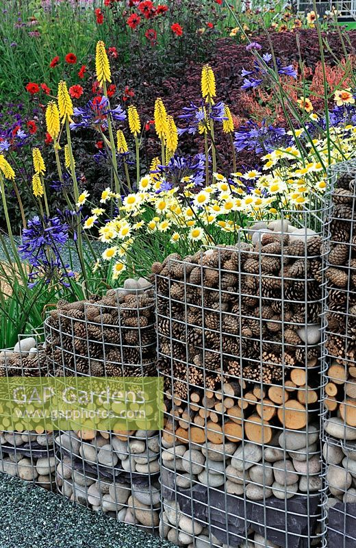 Gabion retaining wall for perennial planting on a slope - RHS Tatton Park Flower Show