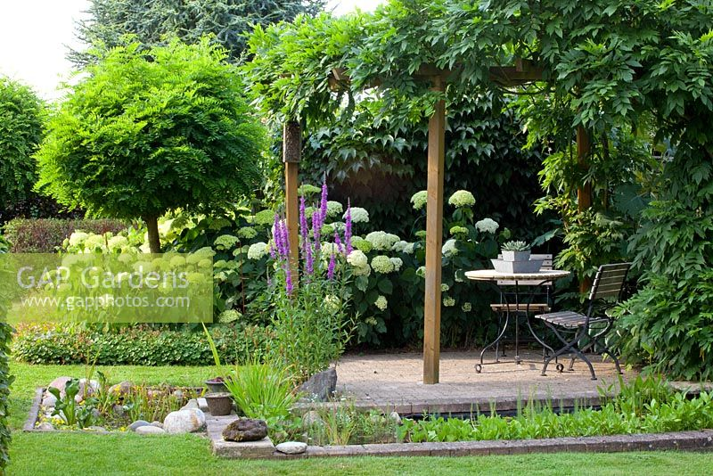 Gap Gardens Patio And Seating Area Under Pergola With