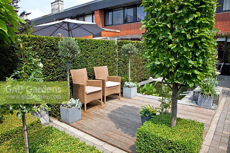 Gap gardens small formal urban garden decked patio with for Small garden areas