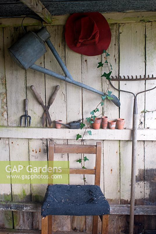 Old tools and chair in potting shed