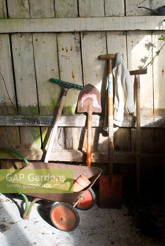 Childrens tools in potting shed