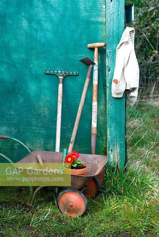 Children's tools by shed door