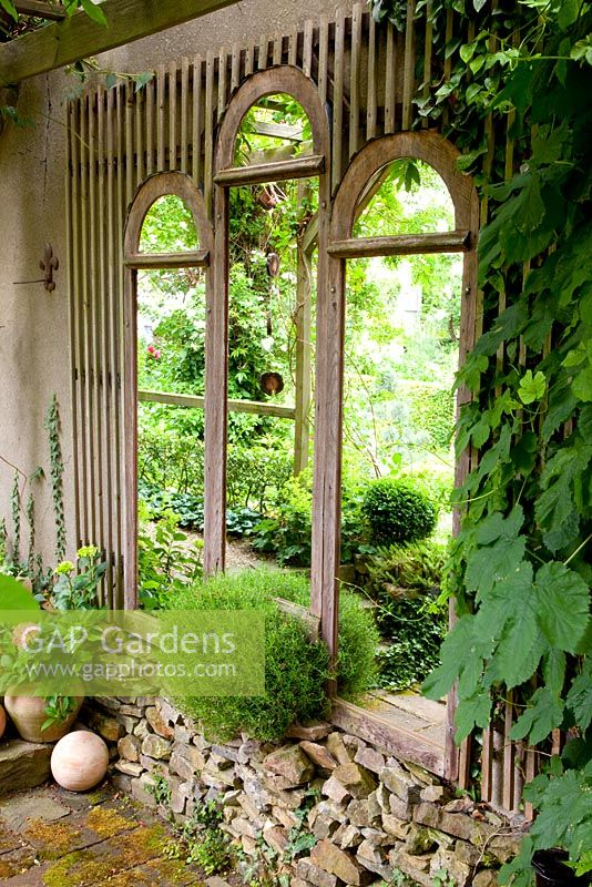 Recycled window frames used as a garden feature