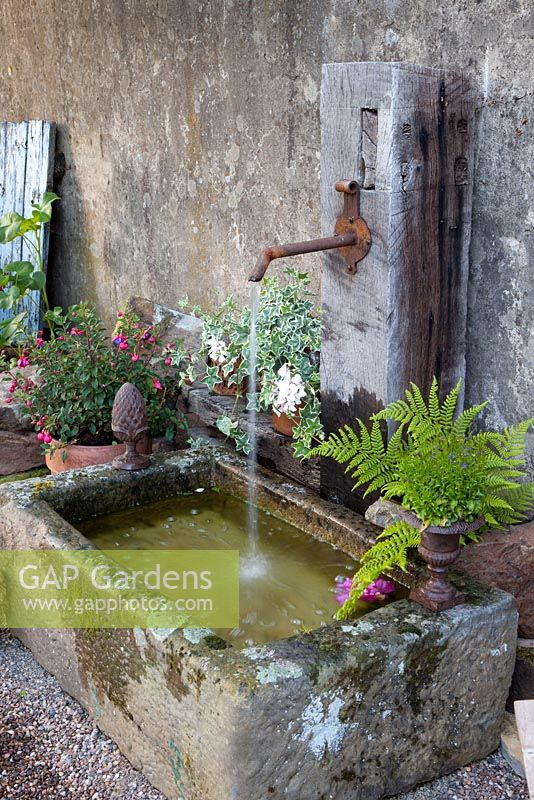 Gap gardens rustic water feature image no 0173142 for Garden pond design books
