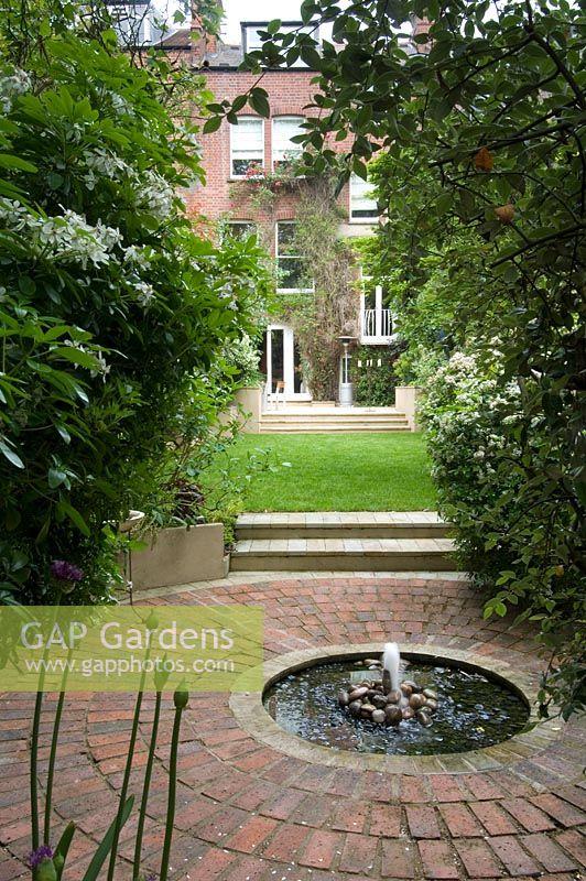 Gap Gardens Urban Garden With Round Pond In The Middle
