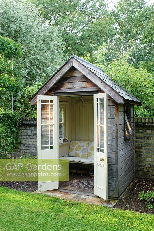 Gap gardens small timber summer house with bench seat for Small garden shelter