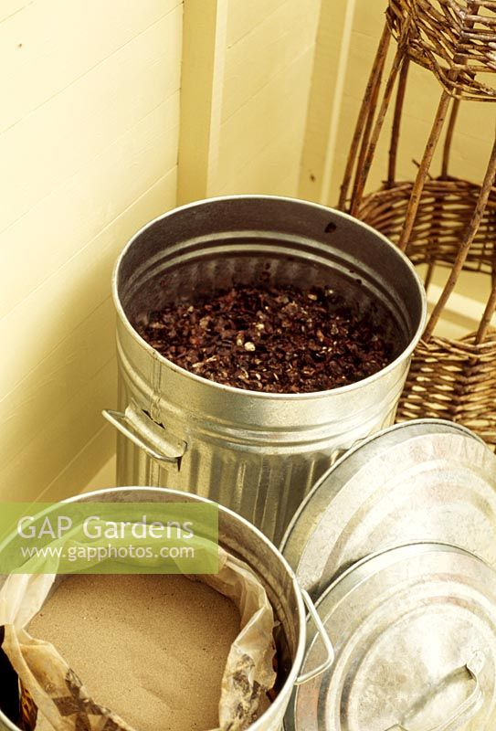 Storing compost and sand in aluminium storage bins inside shed