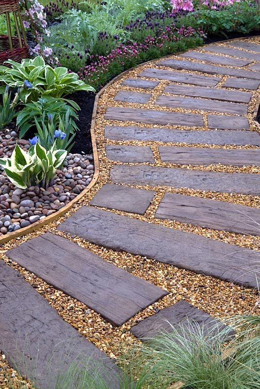 gap gardens - curved path of reused railway sleepers and gravel