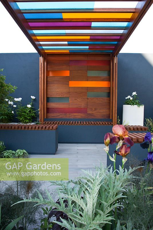 Gap gardens a wooden pergola with coloured glass panels for Coloured glass panels
