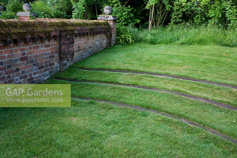 Gap gardens grass steps in walled wild garden the for Wild grass gardens