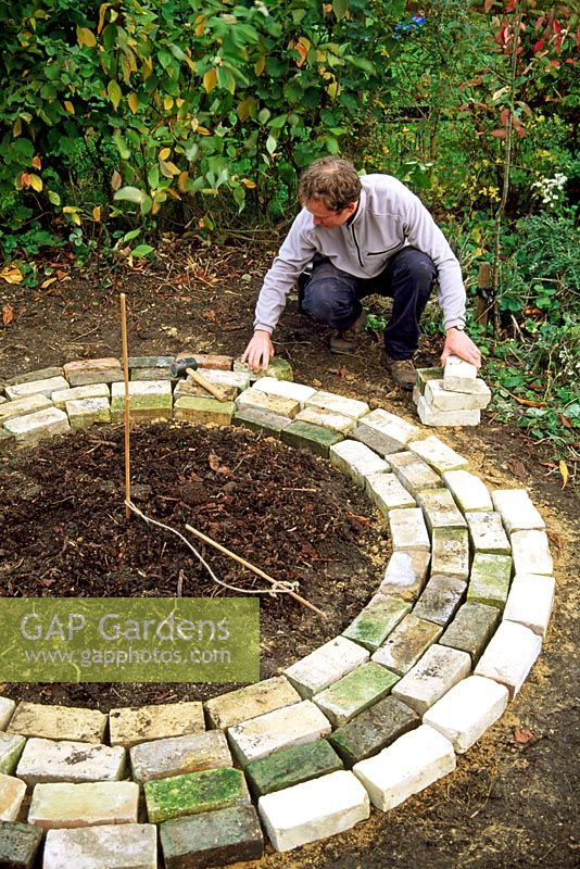 Mini potager - Step 4. Working from the inner circle place concentric rings of reclaimed bricks to form a circular path