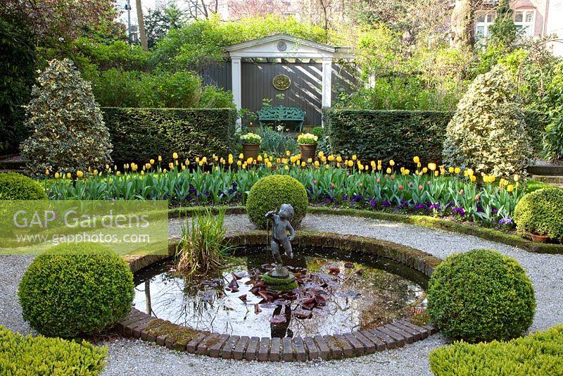Gap gardens formal garden with circular pond beds of for Circular garden ponds