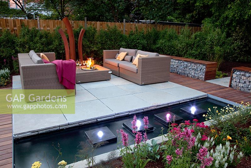 Gap Gardens Small Garden Lit Up At Night With Wicker