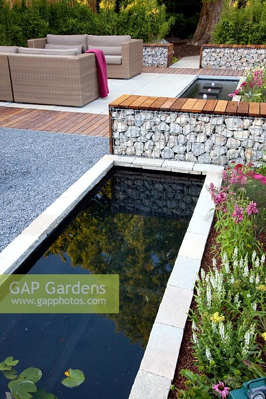 Gap gardens small raised rectangular pond and bench for Garden pool haiti