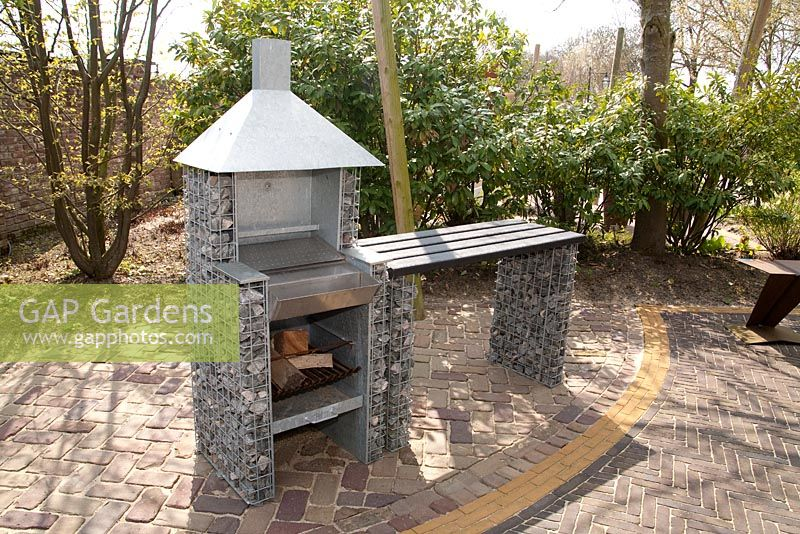 Modern outdoor patio furniture - Gap Gardens Barbeque Made Of Gabions On Patio Appeltern Garden