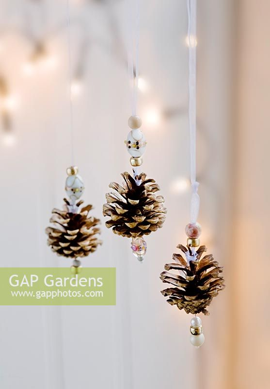 Pine cones decorated at home with beads and pearls