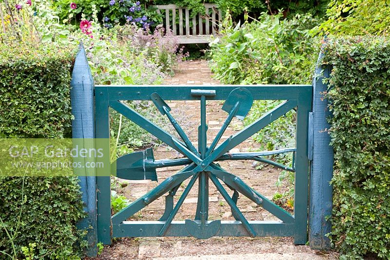 Painted Blue Garden Gate Made From Old Gardening Tools