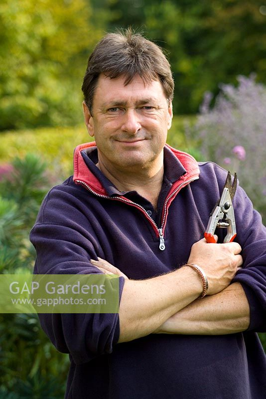 Alan Titchmarsh holding pair of secateurs