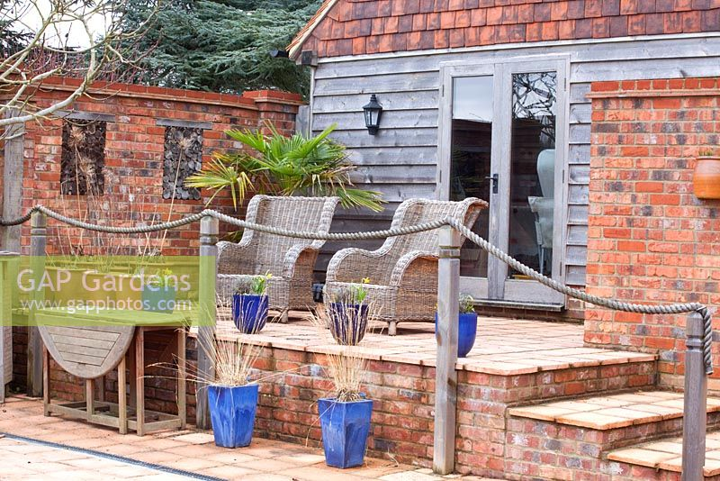 Gap Gardens Wicker Chairs On Raised Patio With Rope
