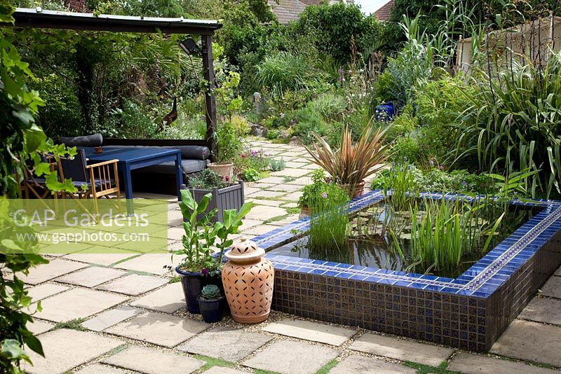 gap gardens moroccan style garden with blue tiled pool