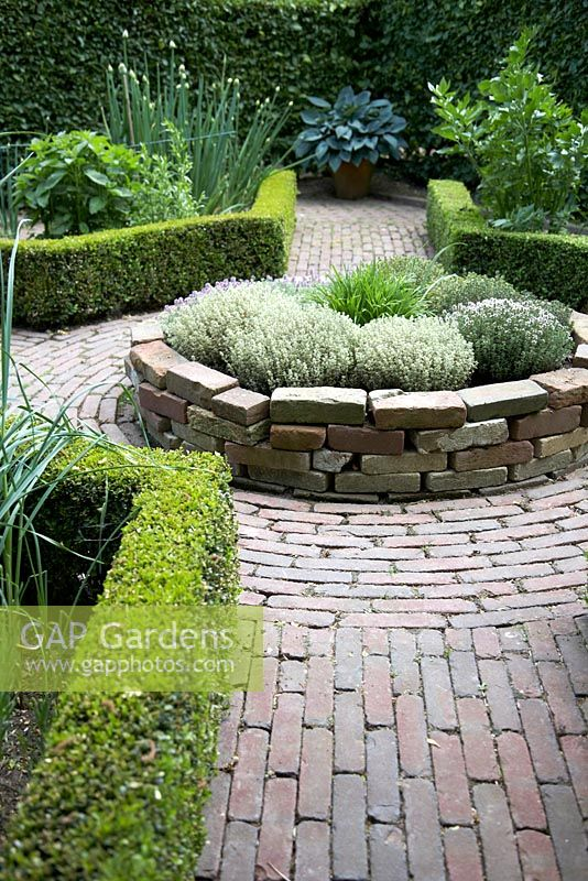 Gap Gardens Herb Parterre With Low Hedging And Circular Raised