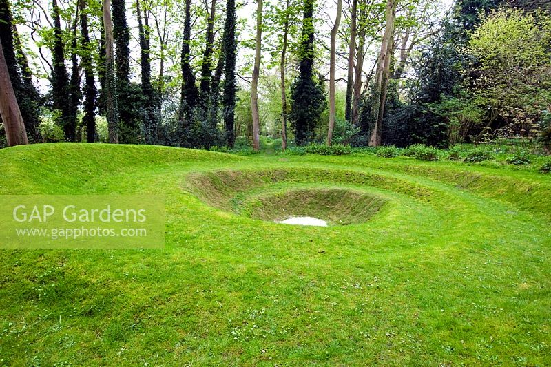 Spiral turf land sculpture at Blakenham Woodland Garden, Suffolk