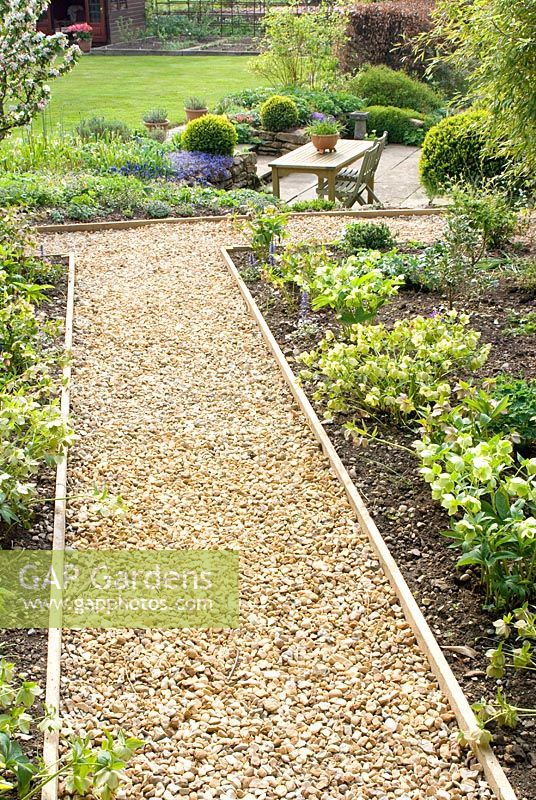 Captivating Gravel Path And Border With Helleborus Leading To Sunken Patio At The  Croft, Flore,