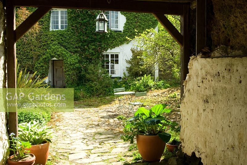 GAP Gardens - View into the cobbled courtyard framed by pots of ...