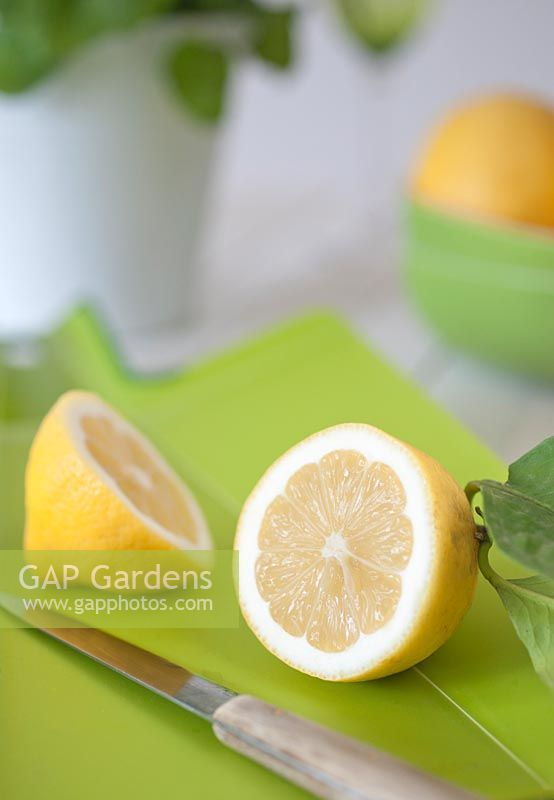 Cut Lemon On Lime Green Chopping Board