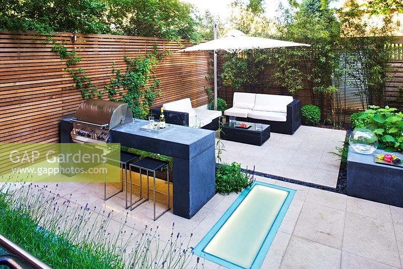 Modern garden with barbecue and dining area